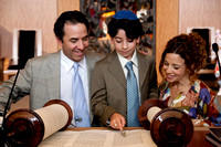 Harrison, with parents Jon and Jennie, reads at his Bar Mitzvah